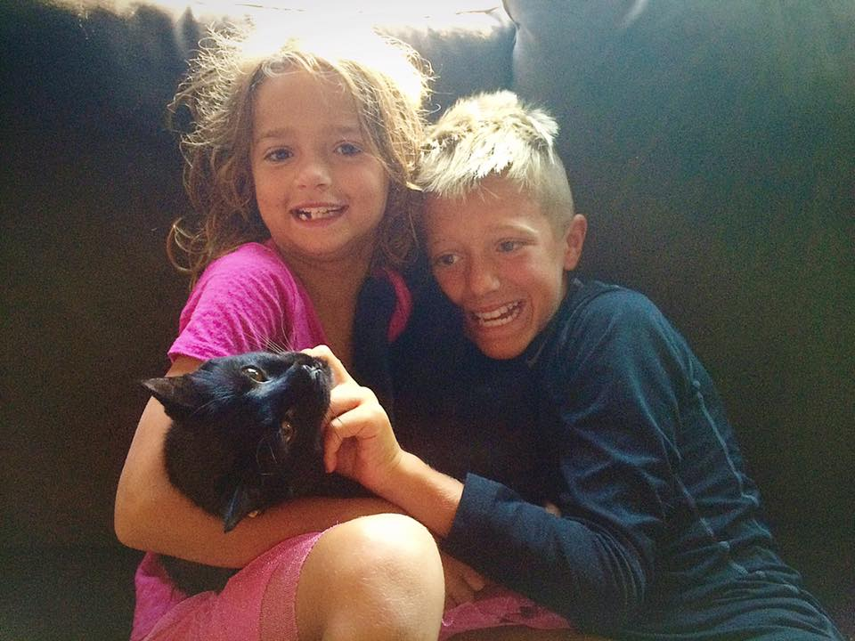 kids and cat that had to be trapped
